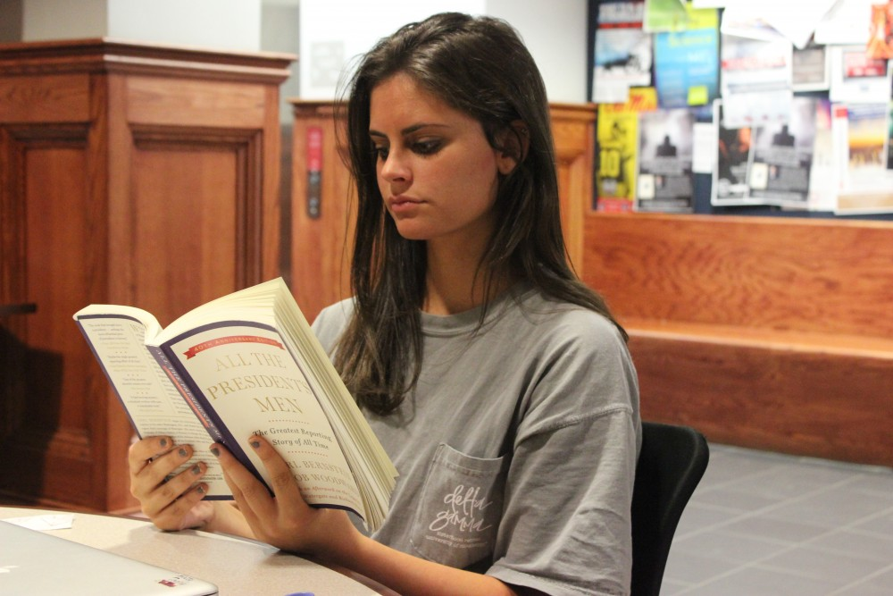 "Shelby Dix from Cape Girardeau, MO is reading ""All the Presidents men"". Dix is in the IMC program and is a senior"