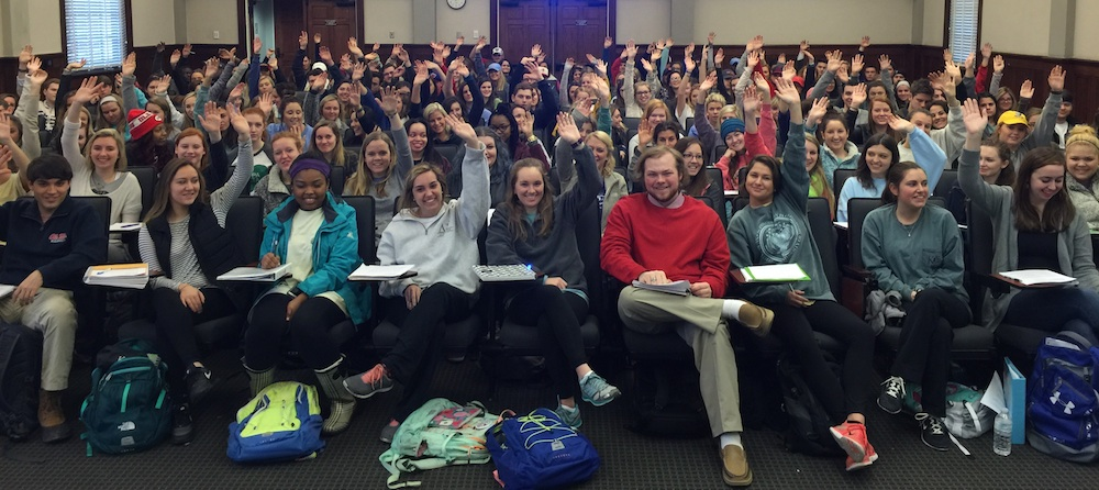 Out-of-state students in Dr. Samir Husni's Journalism 101 class raise their hands