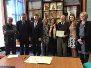 At the William Faulkner Foundation at Rennes University are: (center) Kathleen Wickham, of the Meek School of Journalism and New Media, and Yoknapatawpha Press publisher Larry Wells receiving distinction of Honorary Fellow of the William Faulkner Foundation by U.S. Consul of West France Sara Harriger (2nd from right).